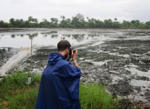 Juraj photographing the oil spill in Goi - packed
